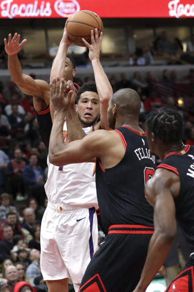 Phoenix Suns guard Devin Booker looks to pass the ball during the second half of the team's NBA basketball game against the Chicago Bulls in Chicago, Saturday, Feb. 22, 2020. The Suns won 112-104. (AP Photo/Nam Y. Huh)