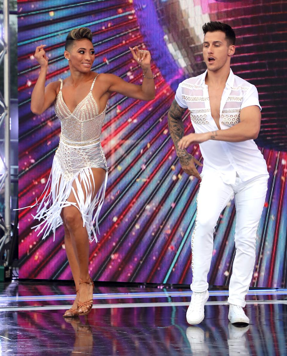 """LONDON, ENGLAND - AUGUST 26:  Karen Clifton and Gorka Marquez on stage at the """"Strictly Come Dancing"""" launch show at Television Centre on August 26, 2019 in London, England. (Photo by Lia Toby/Getty Images)"""