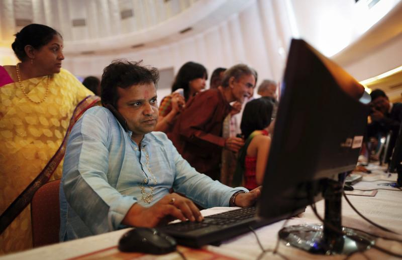 A stockbroker speaks on phone during the Diwali special trading session at the Bombay Stock Exchange in Mumbai