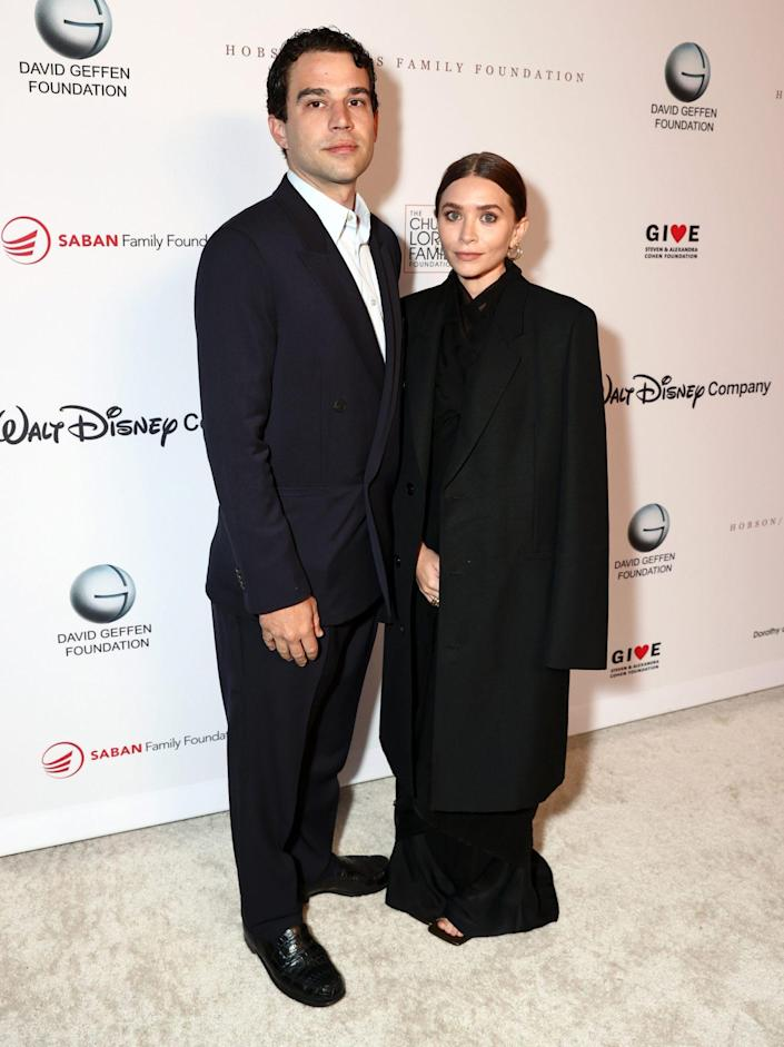 <p> Louis Eisner and Ashley Olsen coordinate in black on Sept. 23 for the YES 20th Anniversary Gala in Los Angeles. </p>