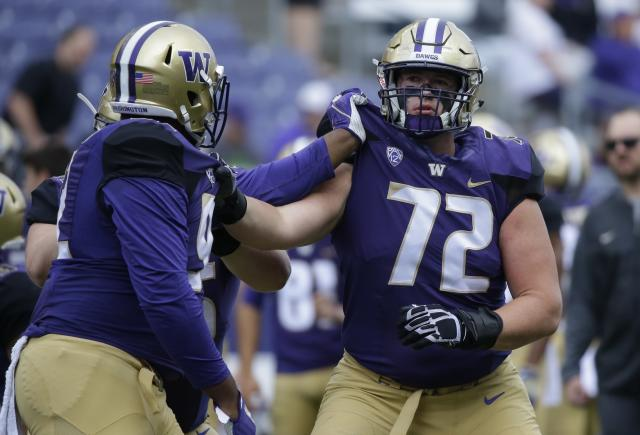 Washington offensive lineman Trey Adams (72) takes part in a warmup drill before an NCAA college football game against Montana, Saturday, Sept. 9, 2017, in Seattle. (AP Photo/Ted S. Warren)