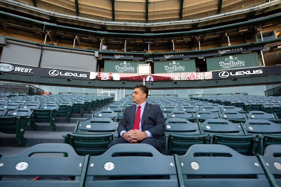 New Angels general manager Perry Minasian sits behind home plate at Angel Stadium.