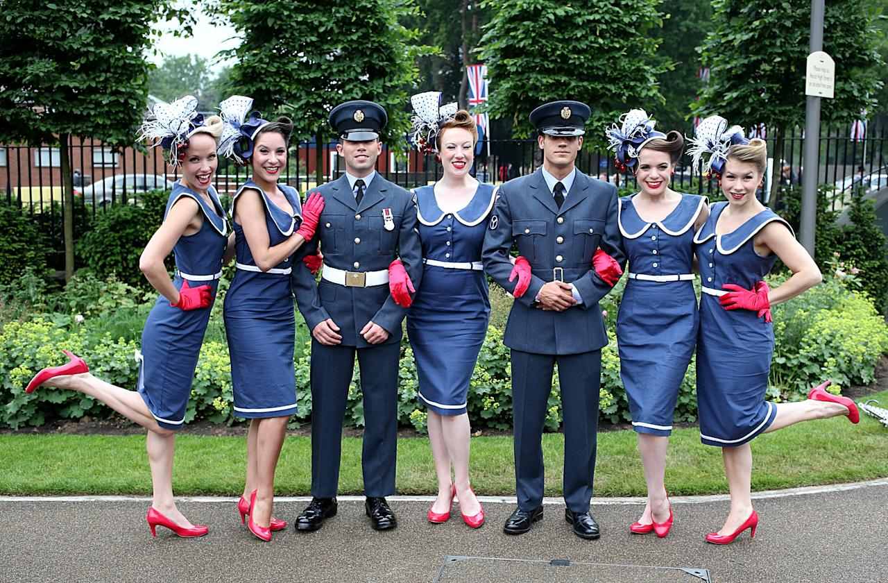 The Tootsie Rollers pose for a photograph with two members of the Royal Air Force during Day Four of The Royal Ascot Meeting 2013.