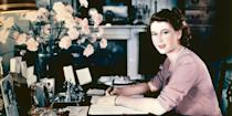 <p>Princess Elizabeth writes a note at her desk in Buckingham Palace.</p>