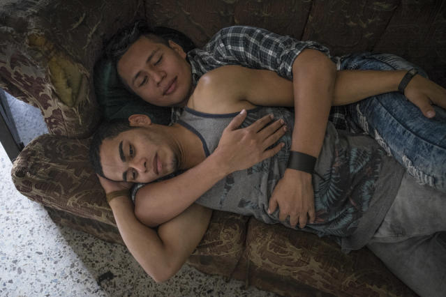 <p>A couple embracing on the sofa in the premises of the LGBT organization Arcoiris, in Tegucigalpa, capital of Honduras. In Honduras having a different kind of sexual orientation or gender identity exposes people to danger an discrimination. This condition of vulnerability is worsened by the conditions of general violence inflicting Honduras, a country where 92% of killings get unpunished.<br>In 2017, there have been 34 murders of LGBT community members in Honduras, according to the observatory on violent deaths of the organization Cattrachas.<br>In Honduras people have spaces to express themselves, such as the annual Gay Pride Parade or beauty contests events, and in a way united they are stronger, but the reality is also that LGBT rights defenders are targeted and killed and homosexuals and transgenders have high difficulties finding a job and walk safely in the streets.<br>Despite the abuses, many of the LGBT members try to lively their nature and by doing so they aim to show the people a reality which they can look away from. (Photo: Francesca Volpi) </p>