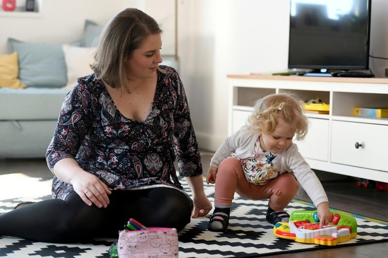 FILE PHOTO: Scharle plays with her daughter at their home in Budakeszi, a western suburb of Budapest