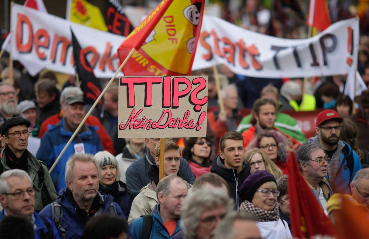 Thousands of demonstrators protest against the planned Transatlantic Trade and Investment Partnership (TTIP) and the Comprehensive Economic and Trade Agreement (CETA) ahead of a visit by President Obama in Hanover, Germany, April 23, 2016.(Markus Schreiber/AP)