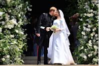 <p>Instead, the couple shared their first kiss as a married couple outside on the church steps in front of a small crowd.</p>