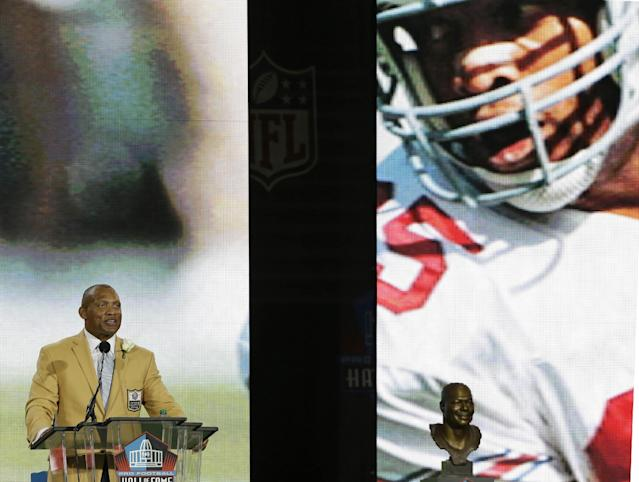 Hall of Fame inductee Aeneas Williams speaks during the Pro Football Hall of Fame enshrinement ceremony Saturday, Aug. 2, 2014, in Canton, Ohio. (AP Photo/Tony Dejak)