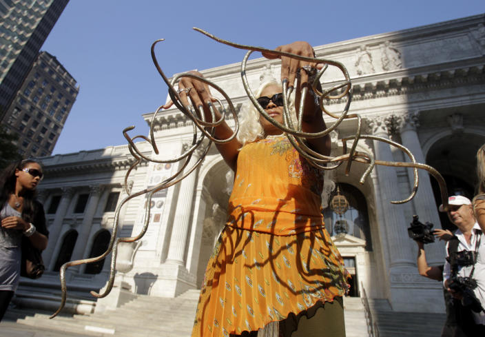 """Chris """"The Dutchess"""" Walton shows off her record breaking fingernails in New York, Wednesday, Sept. 14, 2011. The Dutchess holds the world's record for the longest fingernails on a pair of female hands, according to the new Guiness World Records 2012 book. (AP Photo/Seth Wenig)"""