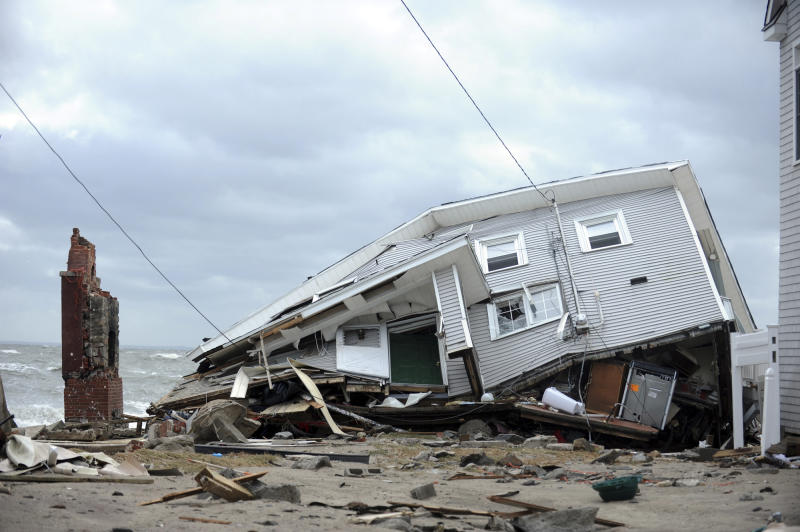 This Oct. 30, 2012 photo shows a house destroyed during Superstorm Sandy on Fairfield Beach Road in Fairfield, Conn.  While Connecticut was spared the destruction seen in New York and New Jersey, many communities along the shoreline, including some of the wealthiest towns in America, were struggling with one of the most severe storms in generations. (AP Photo/The Connecticut Post, Autumn Driscoll) MANDATORY CREDIT