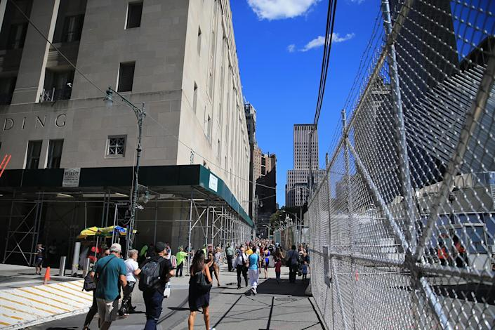 <p>Construction continues on Vesey Street on the northeast side of One World Trade Center, Aug. 23, 2016. The temporary entrance for the PATH Train on Vesey Street closed after the World Trade Center Transportation Hub opened in August 2016. (Gordon Donovan/Yahoo News) </p>