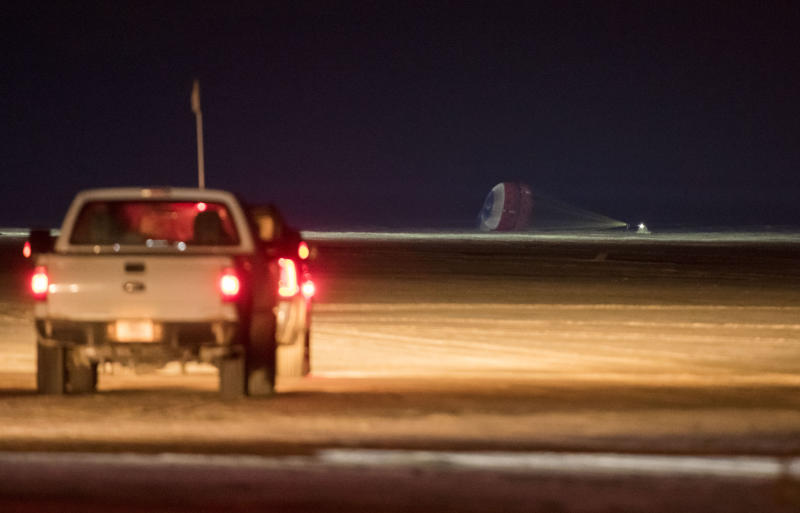 The Boeing CST-100 Starliner spacecraft lands in White Sands, N.M., Sunday, Dec. 22, 2019. Boeing safely landed its crew capsule in the New Mexico desert Sunday after an aborted flight to the International Space Station that threatened to derail the company's effort to launch astronauts for NASA next year. (Aubrey Gemignani/NASA via AP)