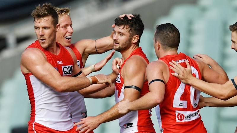 Four goals from Isaac Heeney (2L) have led Sydney to a three-point round-one AFL win over Adelaide