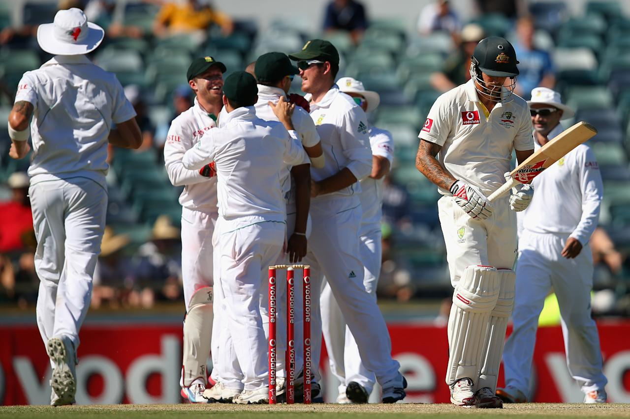 PERTH, AUSTRALIA - DECEMBER 03: Mitchell Johnson of Australia walks off the field after being dismissed by Vernon Philander of South Africa during day four of the Third Test Match between Australia and South Africa at the WACA on December 3, 2012 in Perth, Australia.  (Photo by Cameron Spencer/Getty Images)
