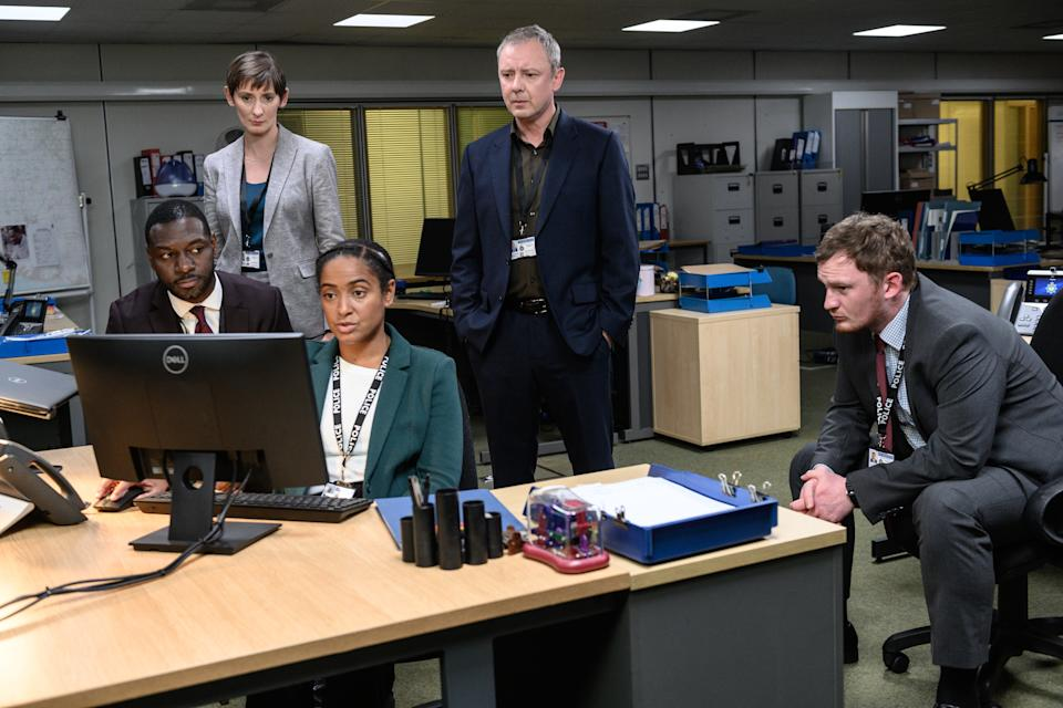 ITV STUDIOS FOR ITV GRACE SERIES 1 DEAD SIMPLE  Pictured:JOHN SIMM as DS Roy Grace,RICHIE CAMPBELL as DS Branson LAURA ELPHINSTONE as DS Moy,AMAKA OKAFOR as DC Boutwood and BRAD MORRISON as DC Nicholl.  This image is the copyright of ITV and may only be used in direct relation to Grace series 1,2021.