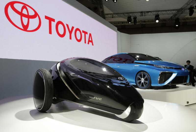 Toyota's FV2, left, and FCV concept cars are displayed at the media preview for the Tokyo Motor Show at the Tokyo Big Sight convention hall in Tokyo, Wednesday, Nov. 20, 2013. The biannual exhibition of vehicles in Japan runs for the public from Saturday, Nov. 23 through Dec. 1. (AP Photo/Shizuo Kambayashi)