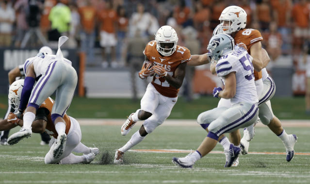 "Texas wide receiver <a class=""link rapid-noclick-resp"" href=""/ncaaf/players/266440/"" data-ylk=""slk:Reggie Hemphill-Mapps"">Reggie Hemphill-Mapps</a> (17) runs against Kansas State during the first half of an NCAA college football game, Saturday, Oct. 7, 2017, in Austin, Texas. (AP Photo/Eric Gay)"