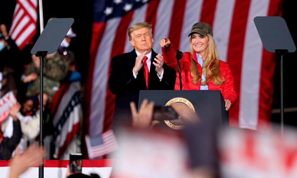 Donald Trump claps as Kelly Loeffler speaks during a campaign rally in Dalton, Georgia, on 4 January.