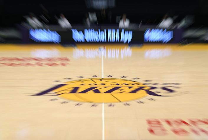 Lakers center court logo during a preseason game.