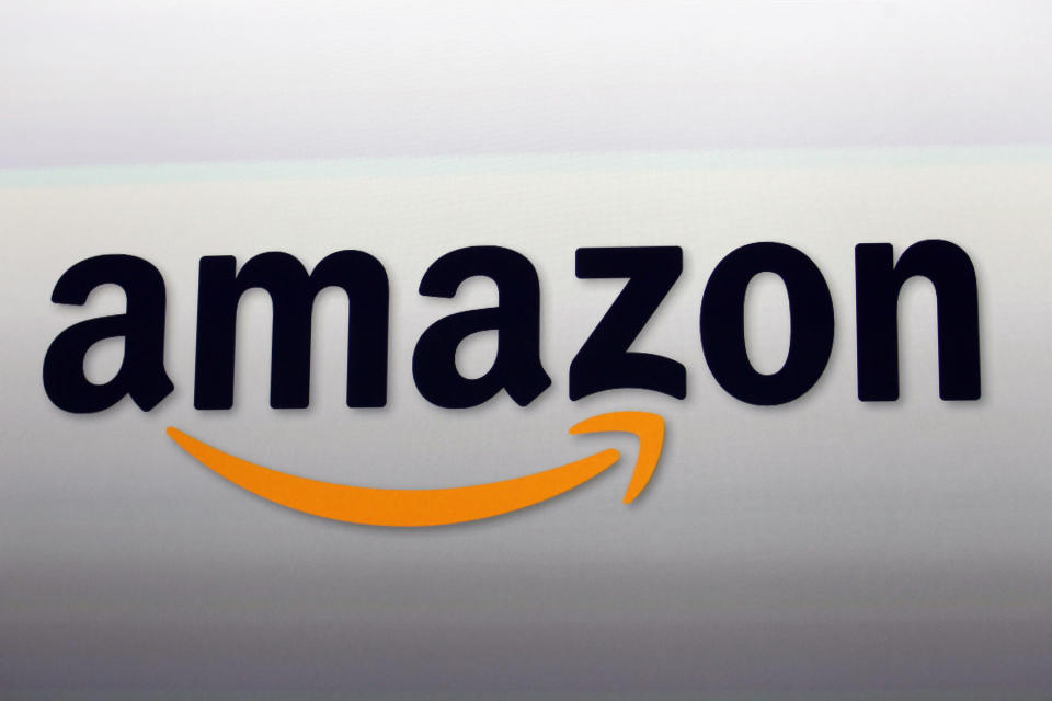 """FILE - This Sept. 6, 2012, file photo, shows the Amazon logo in Santa Monica, Calif. The NFL will nearly double its media revenue to more than $10 billion a season with new rights agreements announced Thursday, March 18, 2021 including a deal with Amazon Prime Video that gives the streaming service exclusive rights to """"Thursday Night Football"""" beginning in 2022 (AP Photo/Reed Saxon, File)"""