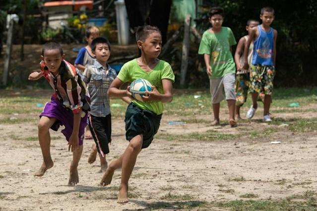 Barefoot on the park: Myanmar's Little Dragons rugby team train in the North Dagon township (AFP Photo/Sai Aung MAIN)