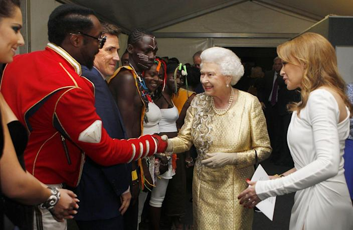 <p> will.i.am dressed in a red military jacket and pants when he met Queen Elizabeth after his performance at her Diamond Jubilee Concert.</p>