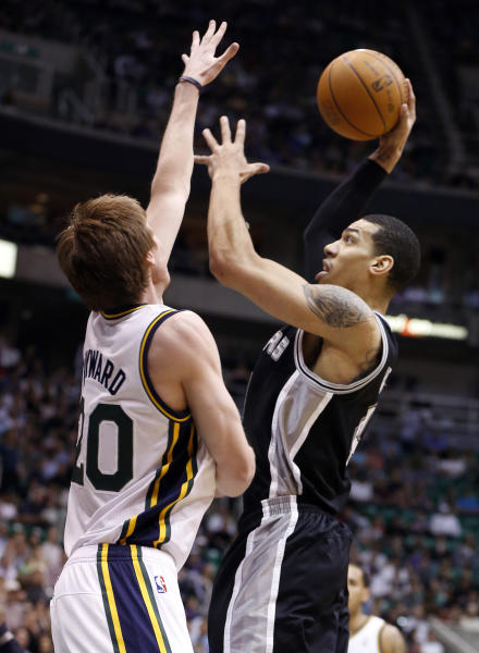 San Antonio Spurs guard Daniel Green, right, shoots over Utah Jazz guard Gordon Hayward during the first half of an NBA basketball game Monday, April 9, 2012, in Salt Lake City. (AP Photo/Jim Urquhart)