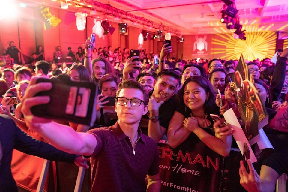 <p>Tom Holland takes selfie with fans during the <em>Spider-Man: Far From Home</em> Pan-Asian Media Summit Bali event on May 27, 2019 in Denpasar, Bali, Indonesia.</p>