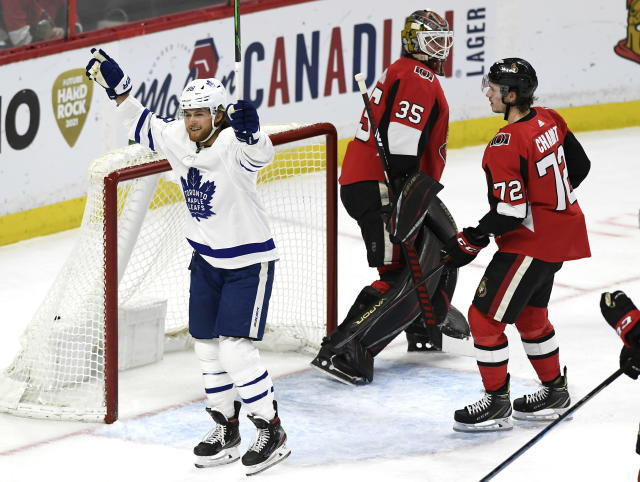 Toronto Maple Leafs right wing William Nylander (88) celebrates a goal in front of Ottawa Senators goaltender Marcus Hogberg (35) and defenseman Thomas Chabot (72) during second-period NHL hockey game action in Ottawa, Ontario, Saturday, Feb. 15, 2020. (Justin Tang/The Canadian Press via AP)