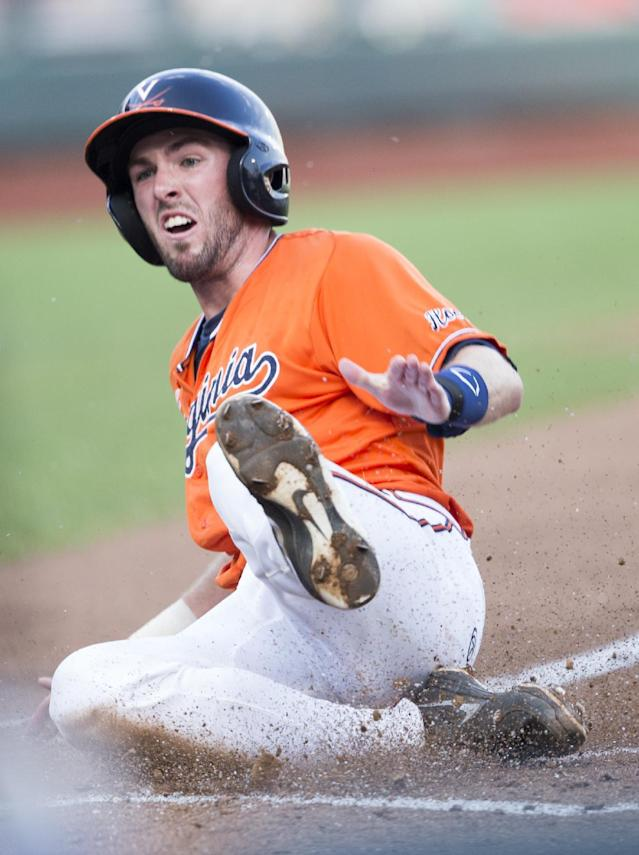 Virginia's Branden Cogswell scores against TCU on a throwing error in the first inning of an NCAA baseball College World Series game in Omaha, Neb., Tuesday, June 17, 2014. (AP Photo/Nati Harnik)