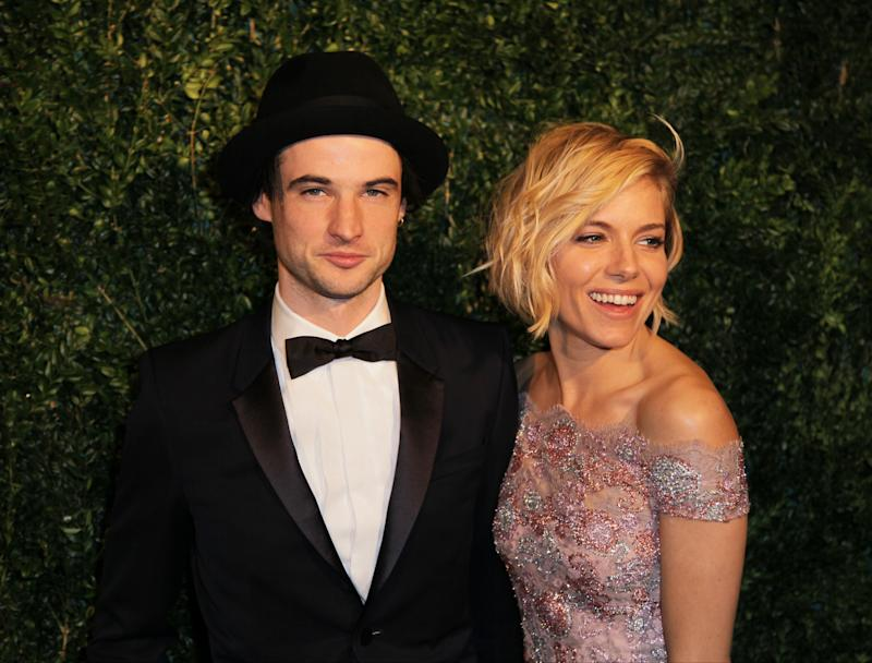 Actors Tom Sturridge and Sienna Miller pose for photographers on arrival at the Evening Standard Theatre Awards, on Sunday Nov 30, 2014 in Central London. (Photo by Grant Pollard/Invision/AP)