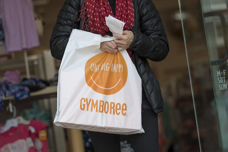 A customer carries a shopping bag while exiting a Gymboree Corp. store in San Francisco, California.