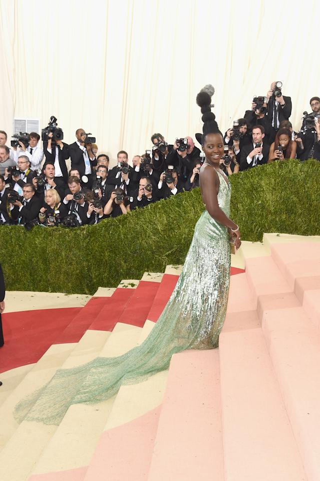 <p>Sure, the foam green dress with cascading sequins is beautiful — but it's Lupita Nyong'o's hair, not unlike that of Marge from the <i>Simpsons</i>, that really made a statement. <i>(Photo: Getty Images)</i></p>
