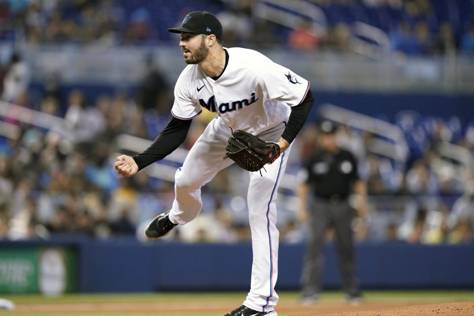 Miami Marlins starting pitcher John Curtiss follows through on a delivery during the first inning of a baseball game against the San Diego Padres, Sunday, July 25, 2021, in Miami. (AP Photo/Lynne Sladky)