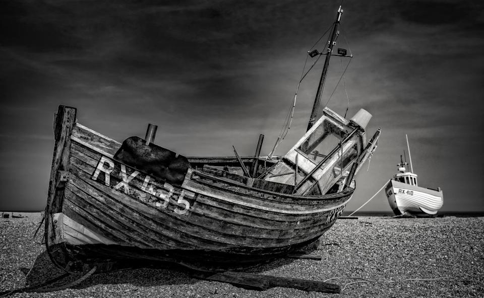 <p>This image of two abandoned ships left on the pebbly Dungeness Beach, won the 'Ships and Wrecks' category of this year's photography competition. (Image: Alex Iacobet)</p>
