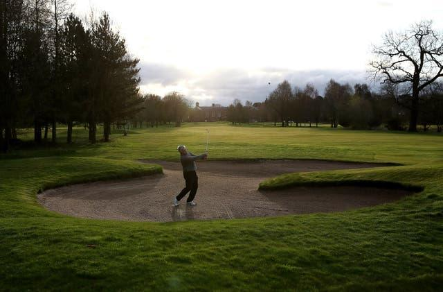 Paul Lambert plays from a bunker by the first green at Vale Royal Abbey Golf Club