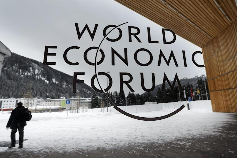 "A man walks outside the main entrance of the Congress Center, on the eve of the opening of the 43rd Annual Meeting of the World Economic Forum, WEF, in Davos, Switzerland, Tuesday, Jan. 22, 2013. The overarching theme of the meeting, which will take place from 23 to 27 January, is ""Resilient Dynamism"". (AP Photo/Keystone, Laurent Gillieron)"