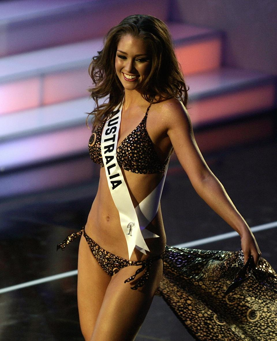 Erin McNaught from Australia takes the catwalk during the Miss Universe 2006 Preliminary Competition in Los Angeles, CA 18 July 2006. (Photo: HECTOR MATA/AFP via Getty Images)