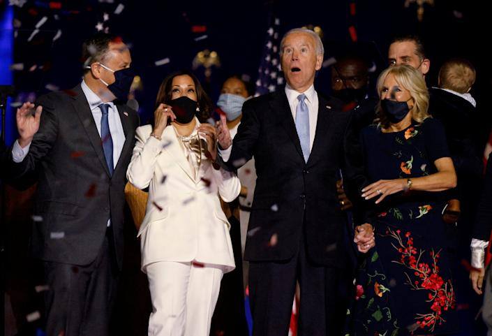 Democratic 2020 U.S. presidential nominee Joe Biden and his wife Jill, and Democratic 2020 U.S. vice presidential nominee Kamala Harris and her husband Doug, react to the confetti at their election rally, after the news media announced that Biden has won the 2020 U.S. presidential election over President Donald Trump, in Wilmington, Delaware, U.S., November 7, 2020.