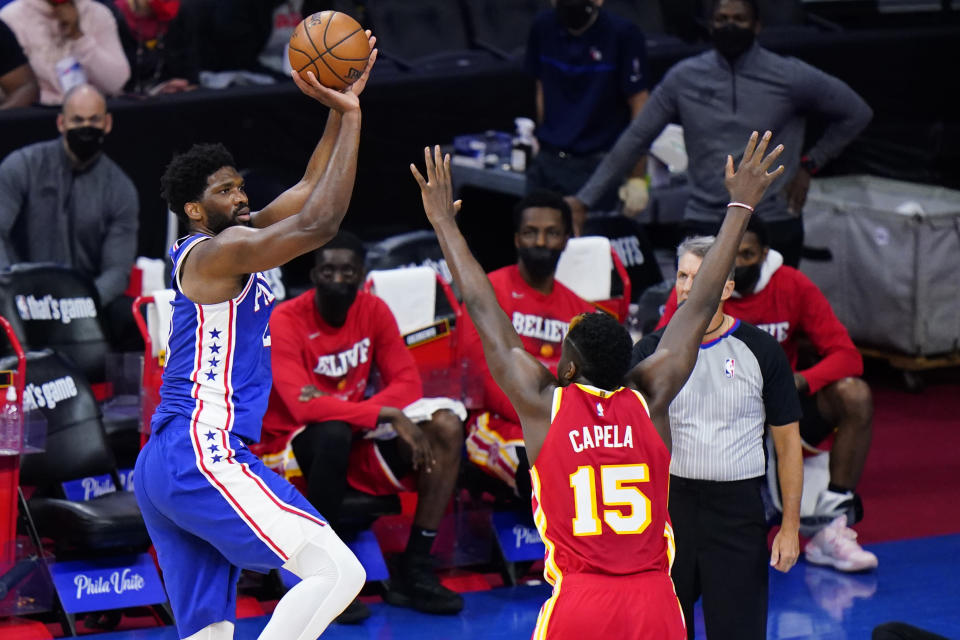 Philadelphia 76ers' Joel Embiid, left, goes up for a shot against Atlanta Hawks' Clint Capela during the second half of Game 2 in a second-round NBA basketball playoff series, Tuesday, June 8, 2021, in Philadelphia. (AP Photo/Matt Slocum)