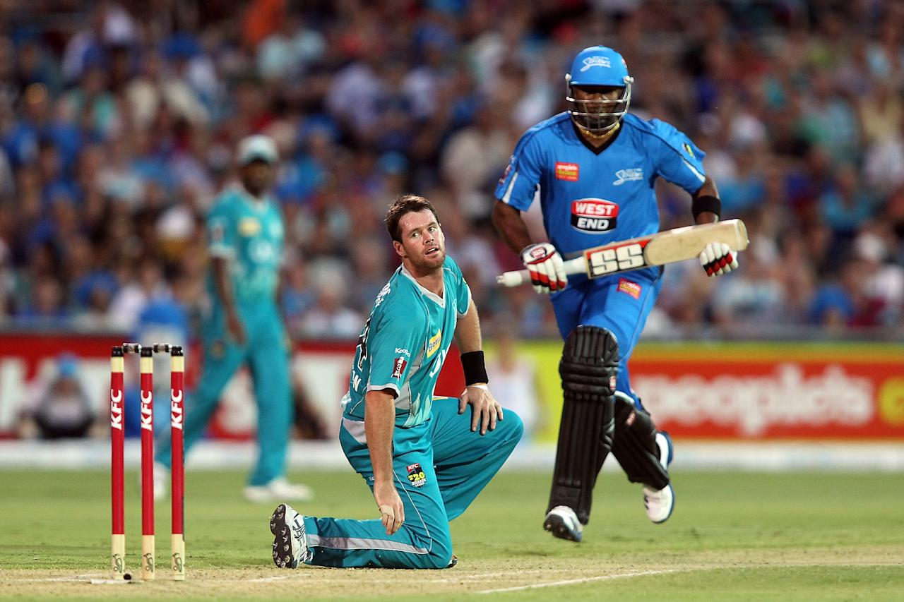 ADELAIDE, AUSTRALIA - DECEMBER 13: Dan Christian of the Heat looks on as Kieron Pollard of the Strikers gets runs from his bowling during the Big Bash League match between the Adelaide Strikers and the Brisbane Heat at Adelaide Oval on December 13, 2012 in Adelaide, Australia.  (Photo by Morne de Klerk/Getty Images)