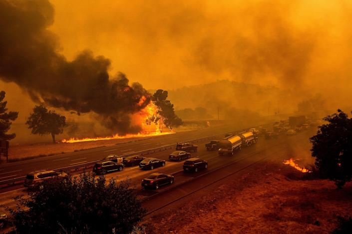 Flames from the LNU Lightning Complex fires along Interstate 80 in Vacaville, Calif., on Aug. 19, 2020. The highway was closed in both directions shortly afterward.