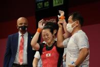 Mikiko Andoh of Japan celebrates after the last lift in the women's 59kg weightlifting event, at the 2020 Summer Olympics, Tuesday, July 27, 2021, in Tokyo, Japan. (AP Photo/Luca Bruno)