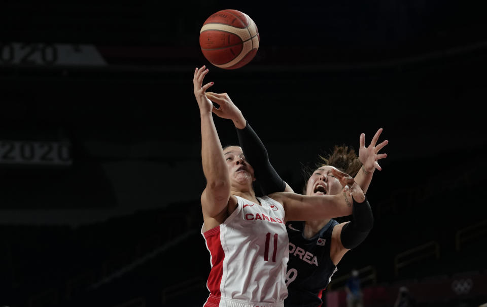 Canada's Natalie Achonwa (11), left, and South Korea's Ji Su Park (19) scramble for a rebound during women's basketball preliminary round game at the 2020 Summer Olympics, Thursday, July 29, 2021, in Saitama, Japan. (AP Photo/Eric Gay)