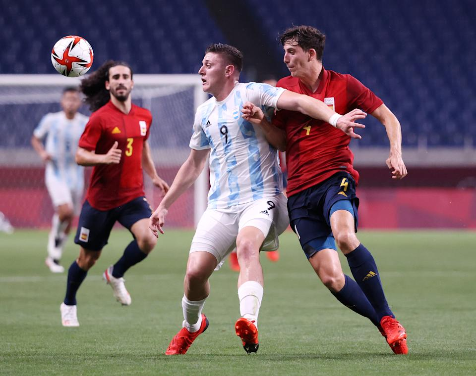 SAITAMA, JAPAN - JULY 28: Adolfo Gaich #9 of Team Argentina battles for possession with Pau Torres #4 of Team Spain during the Men's First Round Group C match between Spain and Argentina on day five of the Tokyo 2020 Olympic Games at Saitama Stadium on July 28, 2021 in Saitama, Japan. (Photo by Atsushi Tomura/Getty Images)