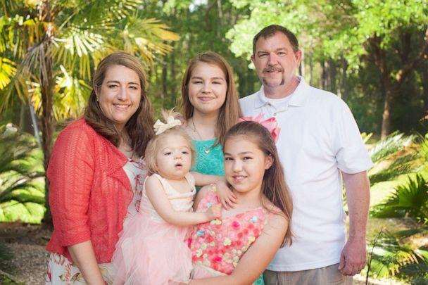 PHOTO: Amber Olsen (left) is pictured with her family. Her daughter, Willow Cannan, has a rare genetic disease, Multiple Sulfatase Deficiency. (United MSD Foundation)