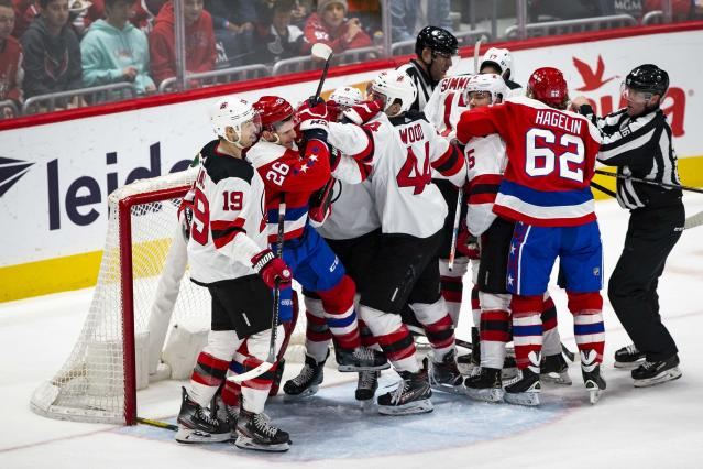 New Jersey Devils left wing Miles Wood (44) and Washington Capitals center Nic Dowd (26) scuffle during the first period of an NHL hockey game Saturday, Jan. 11, 2020, in Washington. (AP Photo/Al Drago)