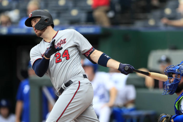 Minnesota Twins' C.J. Cron hits a two-run home run off Kansas City Royals starting pitcher Jorge Lopez during the first inning of a baseball game at Kauffman Stadium in Kansas City, Mo., Sunday, Sept. 29, 2019. (AP Photo/Orlin Wagner)