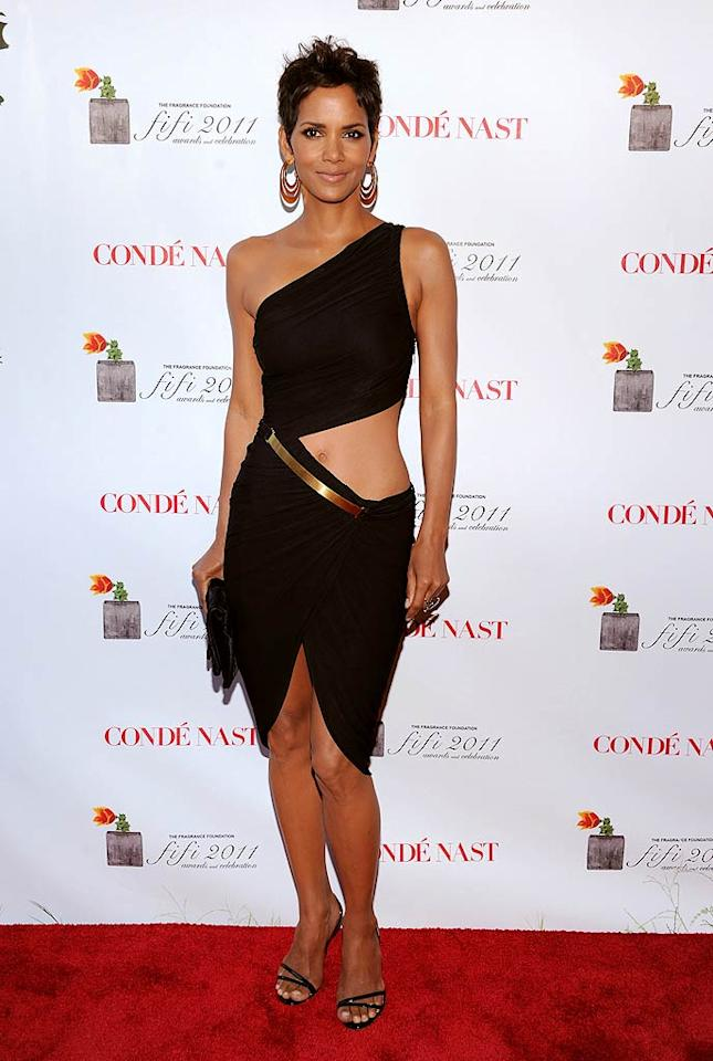 14. Halle Berry -- in a $1,700 Halston cut-out dress, statement earrings, and black strappy sandals -- at the 2011 FiFi Awards. (05/25/2011)